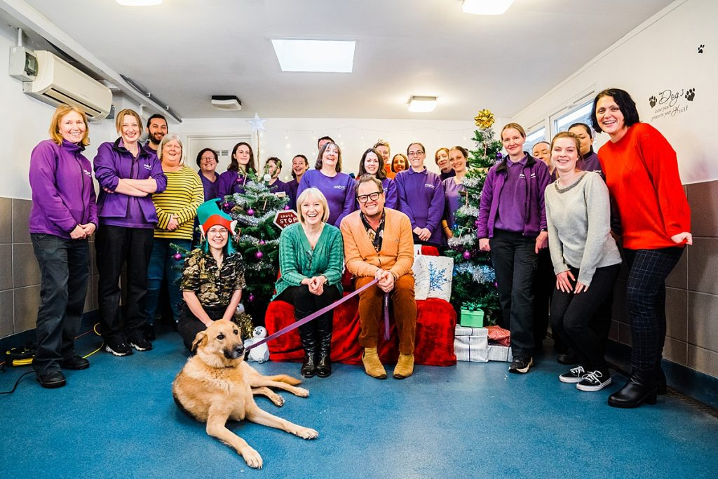 Pet Business Photography - Mayhew team photo with Alan Carr