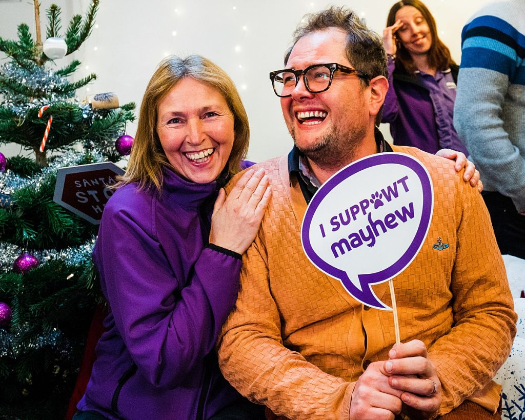 Pet Charity Photography - Mayhew staff laugh with Alan Carr